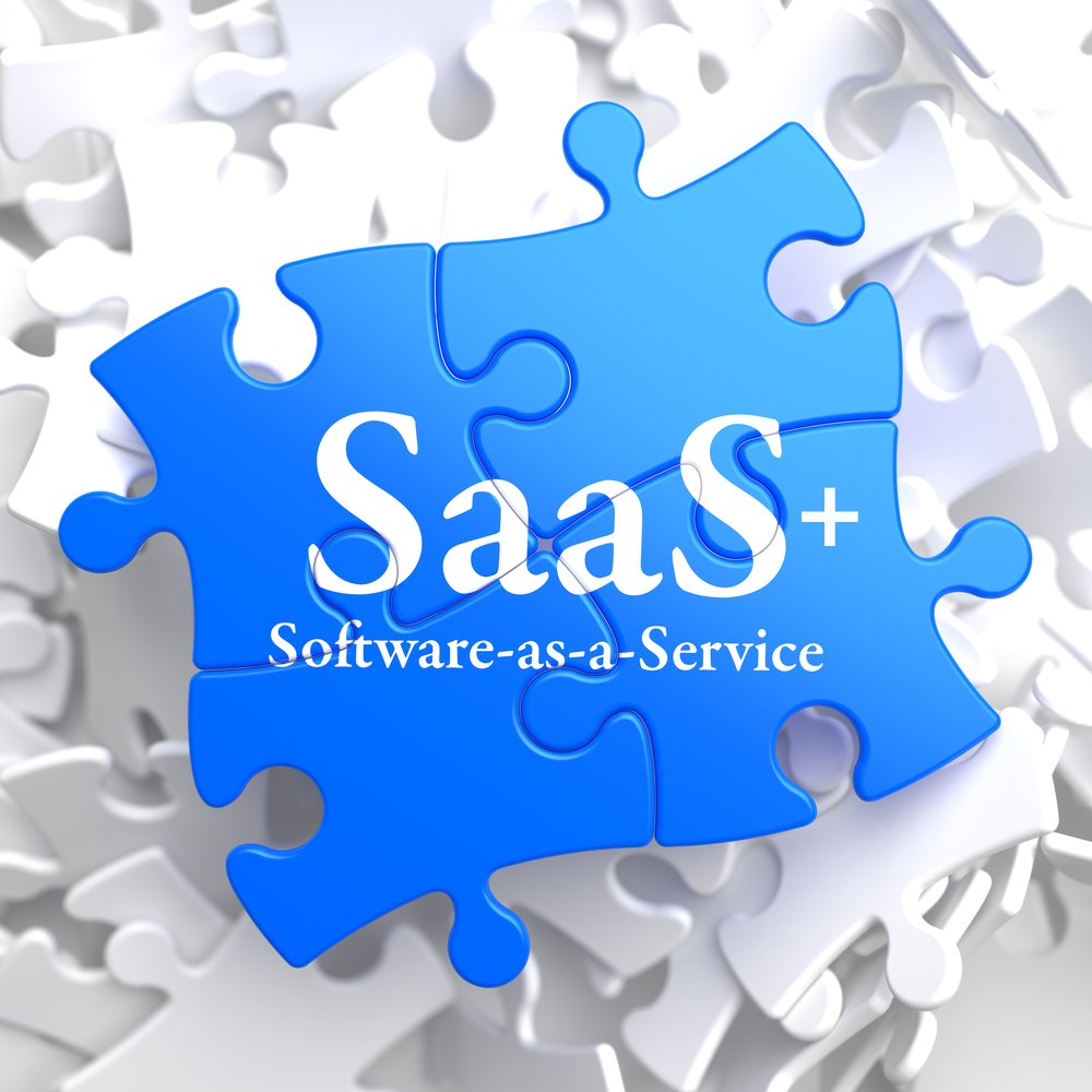 SAAS - Software-as-a-Service - Written on Blue Puzzle Pieces. Information Technology Concept. 3D Render.