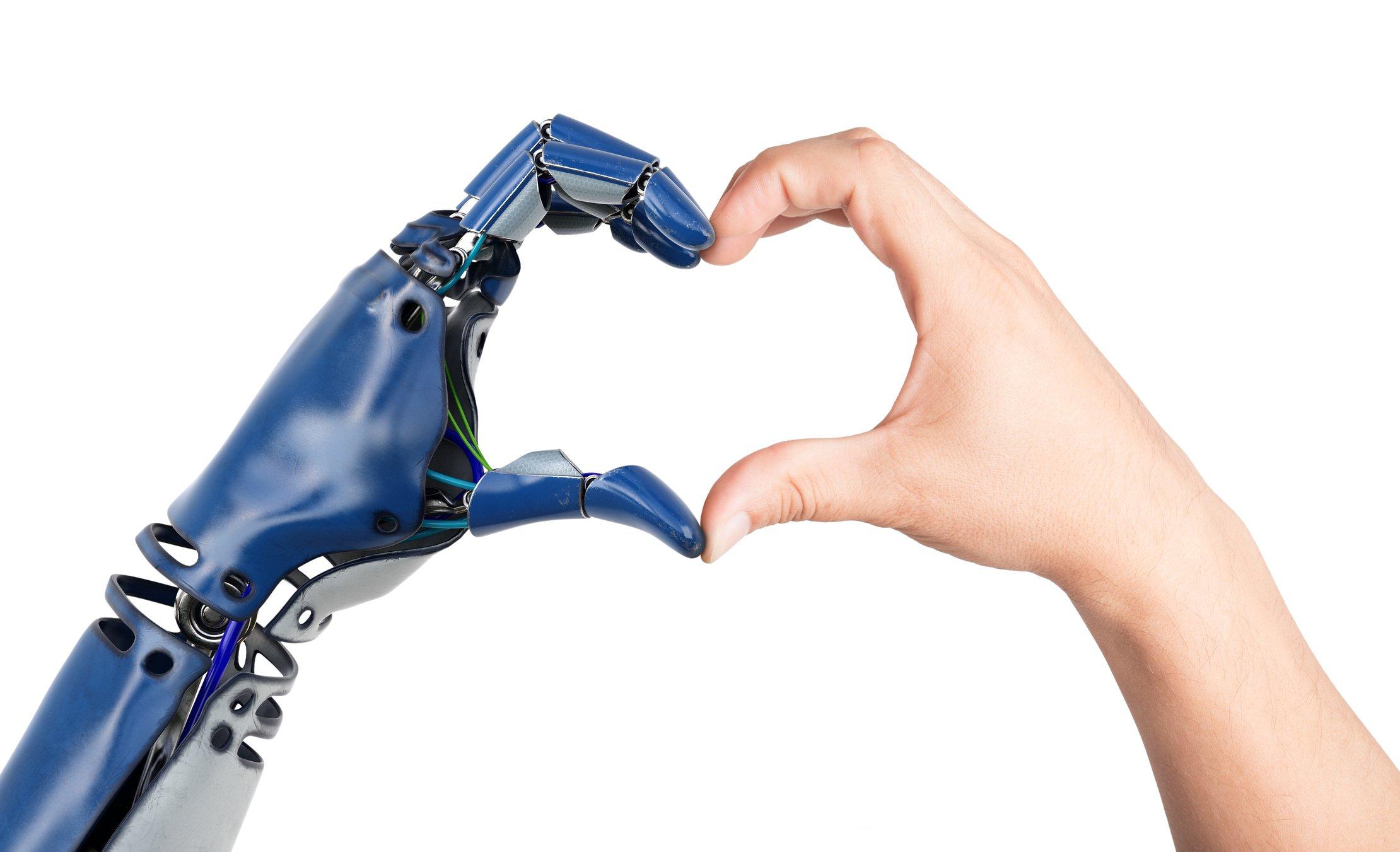 robot_human hand in heart shape